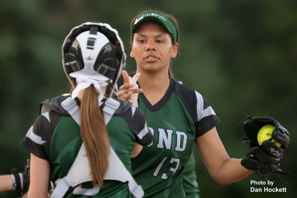 Photo by Dan Hockett West Burlington – Notre Dame Pitcher Alex Yacko celebrates with Catcher Kelci Hill after striking out a Central Lee batter Monday night in West Burlington. WBND defeated Central Lee, 6-0.