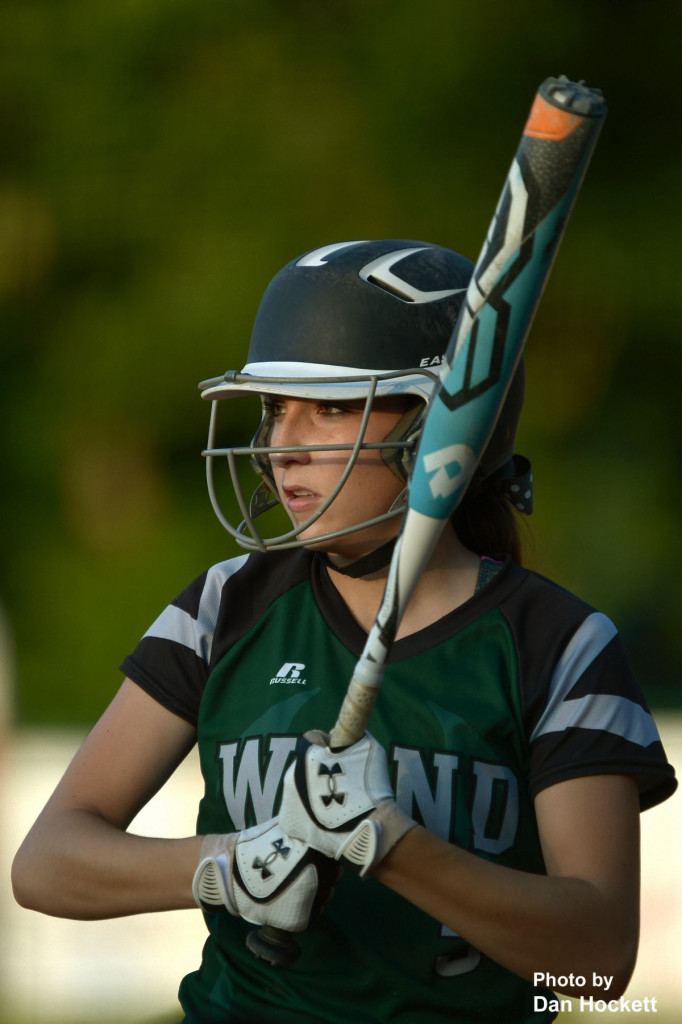 Photo by Dan Hockett West Burlington – Notre Dame Batter Reagan Rogerson looks to coach for the signal before stepping in the batter's box Monday night during the Region-6 Final in Ottumwa. West Burlington – Notre Dame fell to Clarke, 3-2. Photo by Dan Hockett West Burlington – Notre Dame Batter Courtney Coffin prepares for the next pitch Monday night during the Region-6 Final Monday night in Ottumwa. West Burlington – Notre Dame fell to Clarke, 3-2.