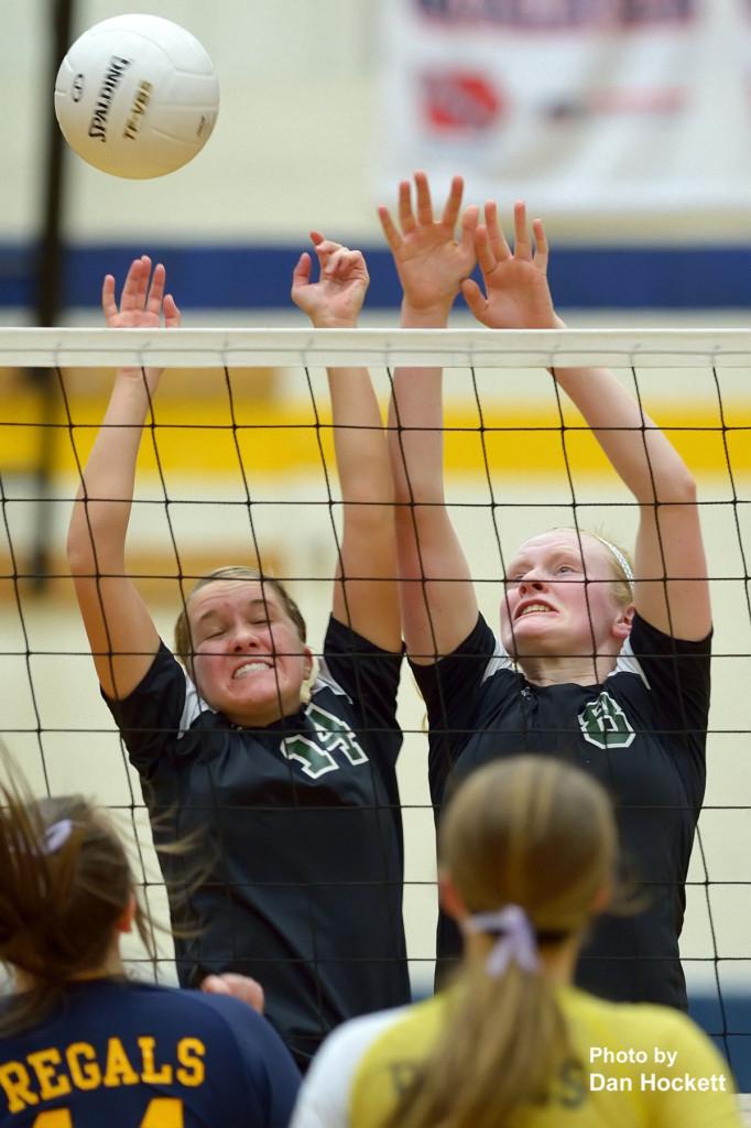 Photo by Dan Hockett West Burlington's ShayLeigh Abbott (left) and Tori Moore (right) try to block an Iowa City Regina spike during Friday night's Region-8 semifinal in Iowa City. Iowa City Regina defeated West Burlington, 25-23, 25-17, 25-16.