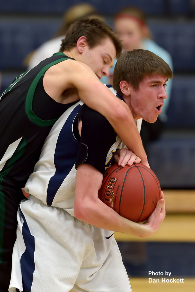 Photo by Dan Hockett Notre Dame's Cody Moehn (right) is fouled by West Burlington's Jared Fogle (left) Tuesday night at Father Minett Gymnasium in Burlington. Notre Dame defeated West Burlington, 62-46.