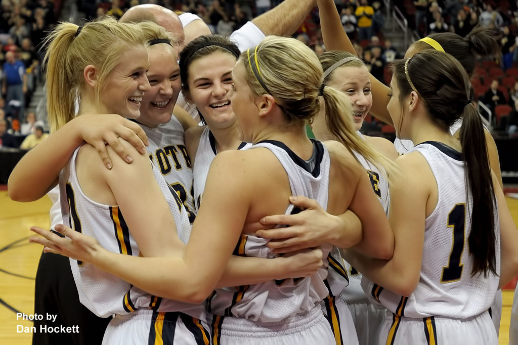 Photo by Dan Hockett Notre Dame Teammates celebrate after winning the Class 1A State Quarterfinal over Adair-Casey Monday afternoon at Wells Fargo Arena in Des Moines. (L-R): Kori Mesecher, Alyssa Schwartz, Riley Killbride, Taylor Hickey, Gabrielle Koelker, Courtney Coffin. Notre Dame defeated Adair-Casey, 90-50.
