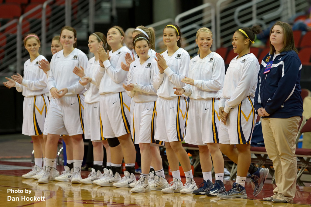 Photo by Dan Hockett Notre Dame Teammates have fun during the introductions before play begins at the Class 1A State Quarterfinal Monday afternoon at Wells Fargo Arena in Des Moines.