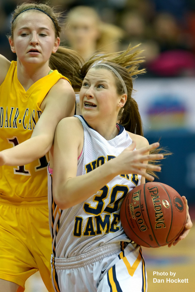 Photo by Dan Hockett Notre Dame's Gabrielle Koelker goes to the basket around past Adair-Casey's Zoey Dinkla during the Class 1A State Quarterfinal Monday afternoon at Wells Fargo Arena in Des Moines. Notre Dame defeated Adair-Casey, 90-50.