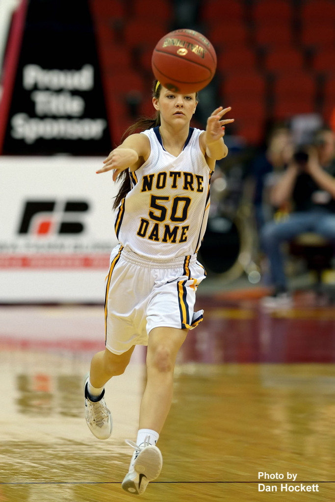 Photo by Dan Hockett Notre Dame's Johanna Myers passes the ball during the Class 1A State Quarterfinal against Adair –Casey Monday afternoon at Wells Fargo Arena in Des Moines.