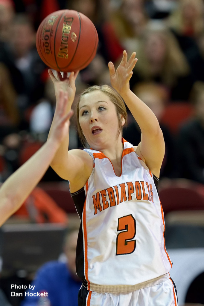 Photo by Dan Hockett Mediapolis' Darby Massner shoots a three against Williamsburg at Wells Fargo Arena Tuesday night in Des Moines.  Mediapolis defeated Williamsburg, 61-43.