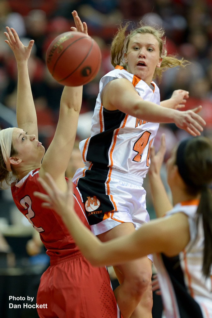 Photo by Dan Hockett Mediapolis' Heidi Hillyard passes the ball through Williamsburg defenders at Wells Fargo Arena Tuesday night in Des Moines.  Mediapolis defeated Williamsburg, 61-43.