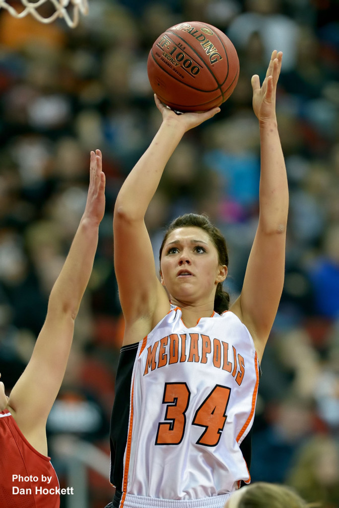 Photo by Dan Hockett Mediapolis' Andrea Larson sends the ball to the basket against Williamsburg at Wells Fargo Arena Tuesday night in Des Moines.  Mediapolis defeated Williamsburg, 61-43.
