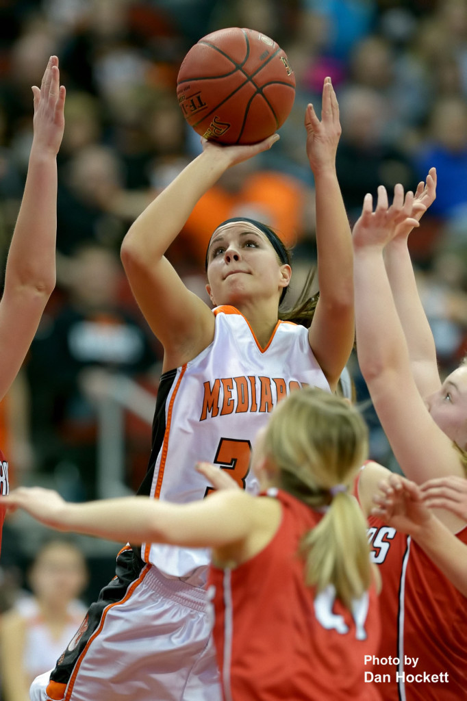 Photo by Dan Hockett Mediapolis' Rachel Holsteen shoots over three Williamsburg defenders in the State Class-3A Quarterfinal at Wells Fargo Arena Tuesday in Des Moines. Mediapolis defeated Williamsburg, 61-43.