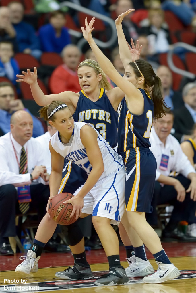 Photo by Dan Hockett Newell-Fonda's Renee Maneman (with ball) finds herself boxed in by Notre Dame's Taylor Hickey (back) and Courtney Coffin (right) during the Class 1A State Girls Championship Friday night at Wells Fargo Arena in Des Moines. Notre Dame defeated Newell-Fonda, 57-54.