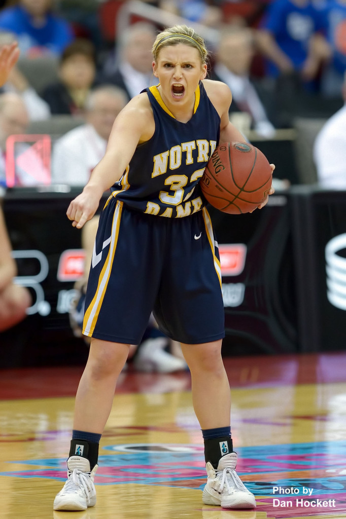 Photo by Dan Hockett Notre Dame's Taylor Hickey shouts out a play during the Class 1A State Girls Championship Friday night at Wells Fargo Arena in Des Moines. Notre Dame defeated Newell-Fonda, 57-54.
