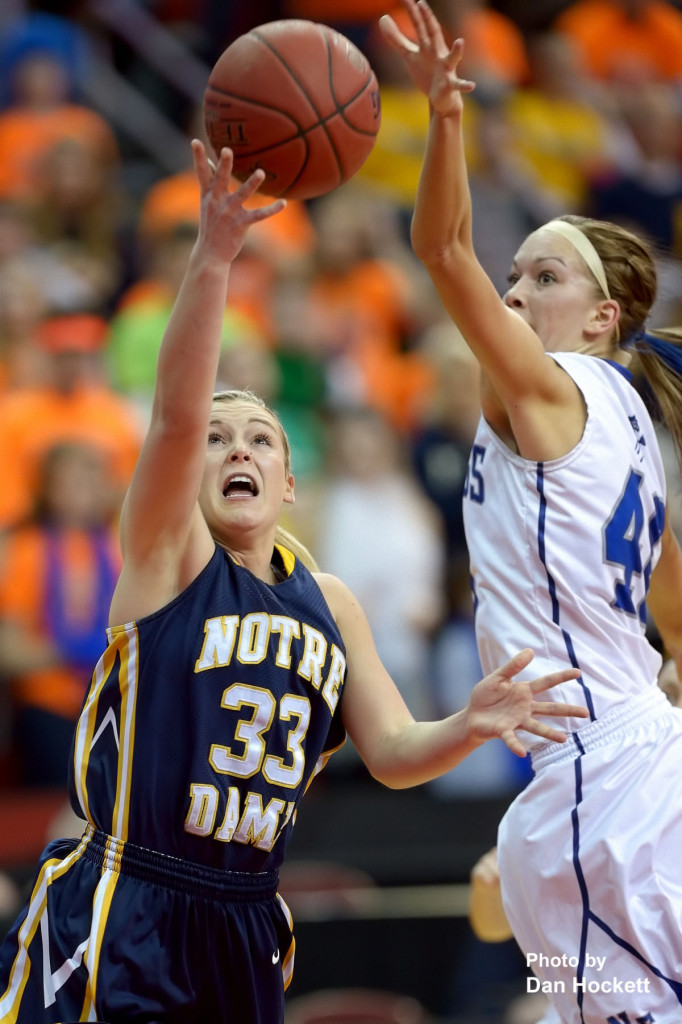 Photo by Dan Hockett Notre Dame's Taylor Hickey (33) shoots around Newell-Fonda's Claudia Larsen (40) during the Class 1A State Girls Championship Friday night at Wells Fargo Arena in Des Moines. Notre Dame defeated Newell-Fonda, 57-54.