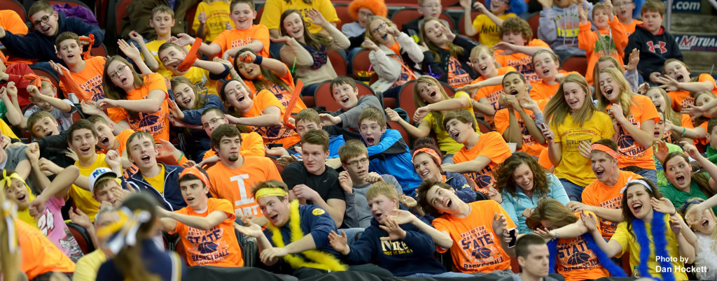 Photo by Dan Hockett Notre Dame Fans cheer on their team at the Class 1A State Girls Championship Friday night at Wells Fargo Arena in Des Moines.