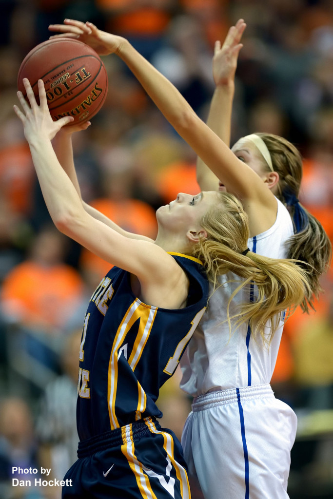 Photo by Dan Hockett Notre Dame's Kori Mesecher has her shot blocked by Newell-Fonda's Claudia Larsen during the Class 1A State Girls Championship Friday night at Wells Fargo Arena in Des Moines. Notre Dame defeated Newell-Fonda, 57-54.