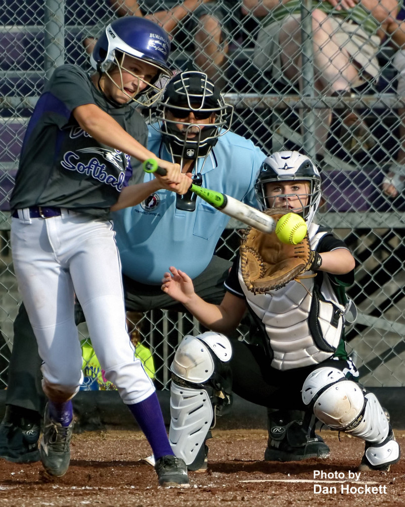 Photo by Dan Hockett Burlington Batter Mia Ruther makes contact in front of West Burlington – Notre Dame Catcher Kelci Hill in the first game of a doubleheader Wednesday in Burlington. Burlington won the first game, 5-1. West Burlington – Notre Dame won the second game, 3-1.