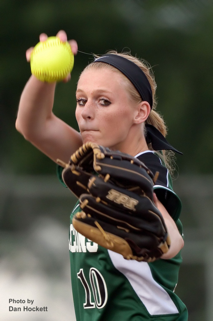 Photo by Dan Hockett West Burlington – Notre Dame Pitcher Kori Mesecher winds up before the release to the plate against New London Thursday night at Barb Carter Field in West Burlington. New London defeated West Burlington – Notre Dame, 7-2.
