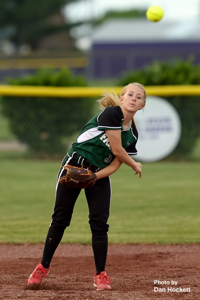 Photo by Dan Hockett West Burlington – Notre Dame Shortstop Richelle Weeks makes the throw to first base after fielding the ball in the first game of a doubleheader Wednesday in Burlington. Burlington won the first game, 5-1. West Burlington – Notre Dame won the second game, 3-1.