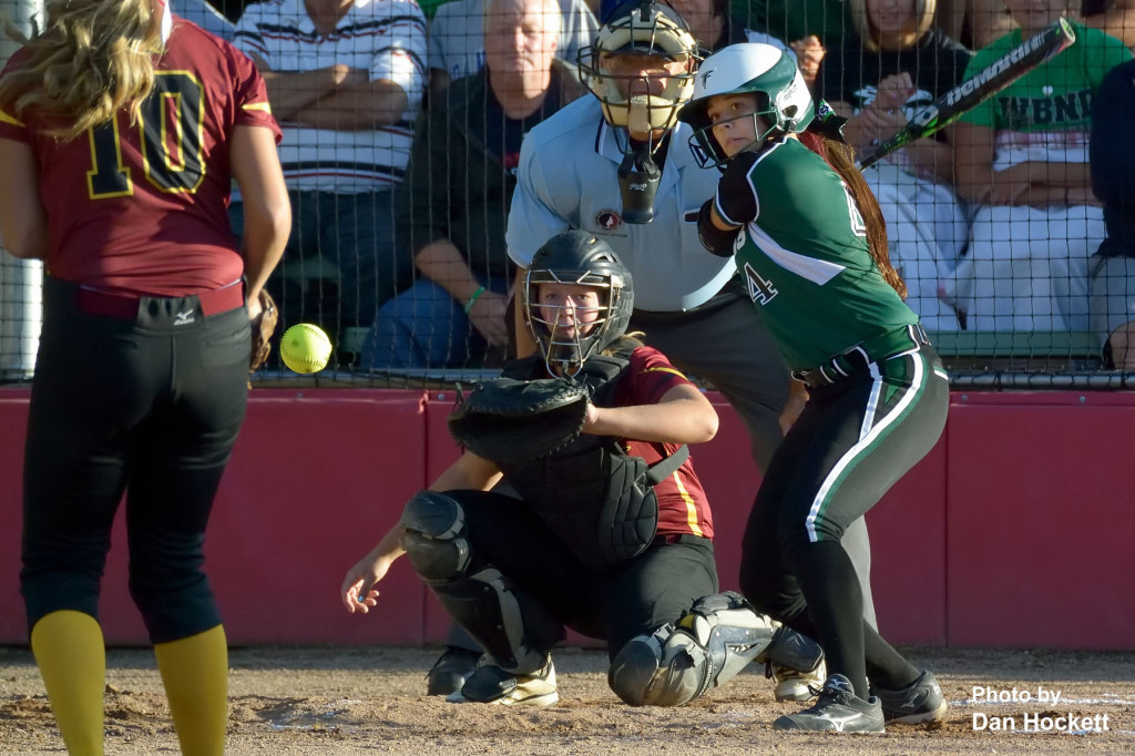 Photo by Dan Hockett West Burlington – Notre Dame Batter Machaella Diaz looks over a pitch from PCM's Racheal Freland to Catcher Abigail Gilson during the Region-7 Final in Ottumwa Monday night. West Burlington – Notre Dame defeated PCM, 6-4.