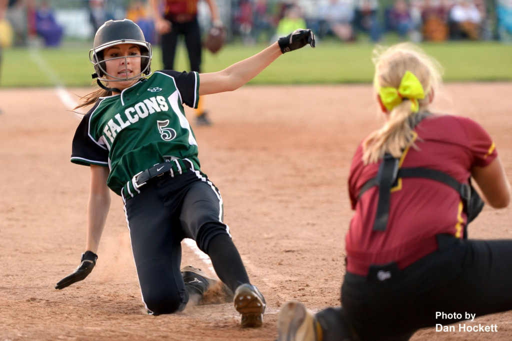 Photo by Dan Hockett West Burlington – Notre Dame's Courtney Coffin is tagged out at home by PCM Catcher Abigail Gilson during the Region-7 Final in Ottumwa Monday night. West Burlington – Notre Dame defeated PCM, 6-4.