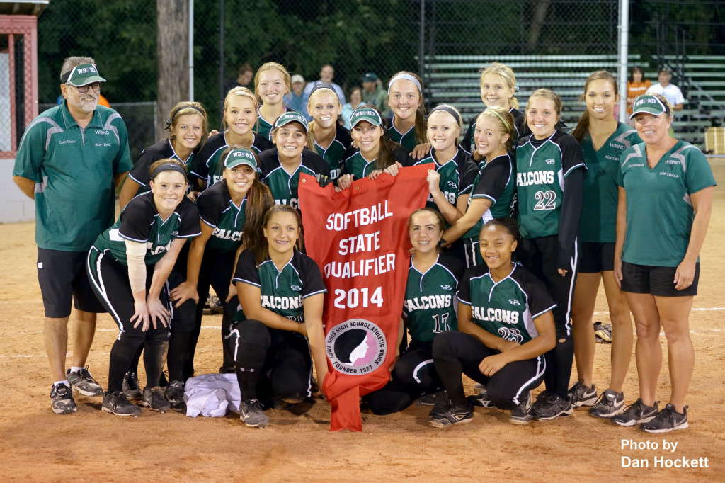 "Photo by Dan Hockett West Burlington – Notre Dame Lady Falcons pose with their ""2014 Softball State Qualifier"" banner Monday night in Ottumwa."
