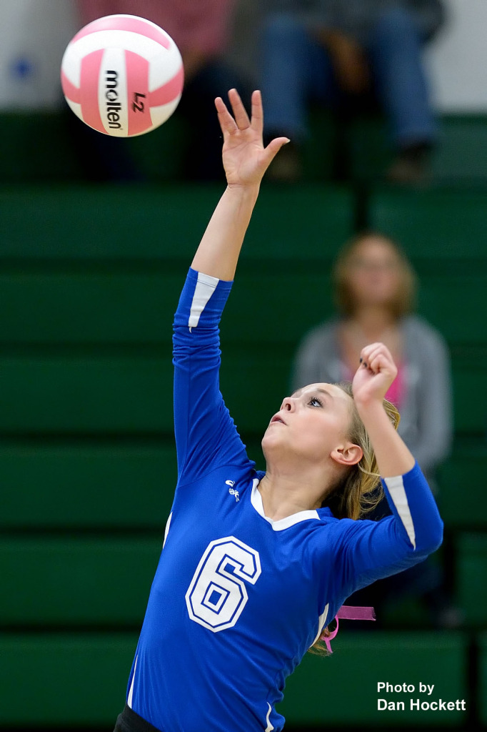 Photo by Dan Hockett Danville's Kaitlyn Hess sends the ball over the net against West Burlington Tuesday night in West Burlington. West Burlington defeated Danville, 25-14, 25-16, 25-20.