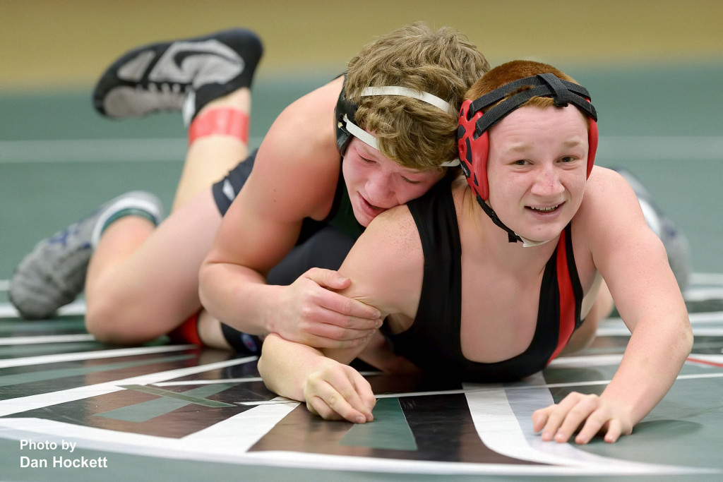 Photo by Dan Hockett WBNDD's Luke Shipley (top) grapples with Cardinal's Austin Bride in the 160lb match Thursday night in West Burlington. WBNDD's Shipley pinned Bride in 39-seconds.