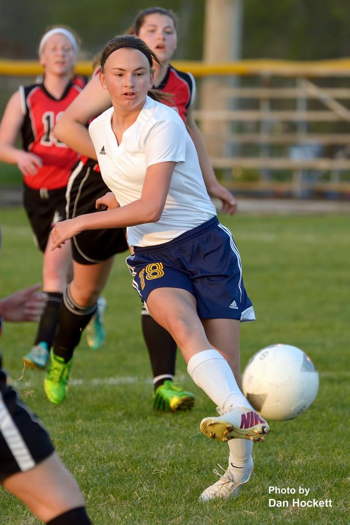 Photo by Dan Hockett Notre Dame – West Burlington – Danville's Kate Luers scores a goal against Fort Madison Thursday night in Burlington. NDWBD defeated Ft. Madison, 10-2.