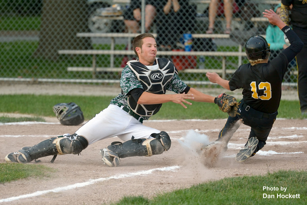 Photo by Dan Hockett West Burlington Catcher Tyson Abbott tags out New London's Britt Noel (13) at the plate Tuesday night in West Burlington. New London defeated West Burlington, 10-7.