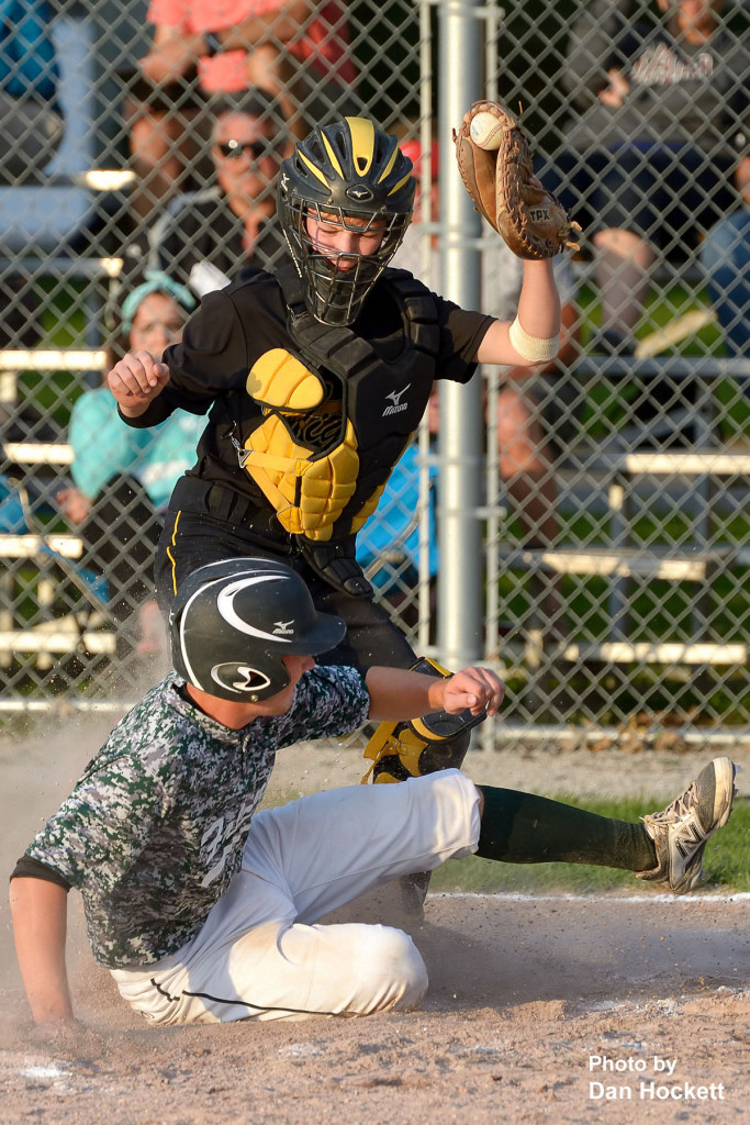 Photo by Dan Hockett New London Catcher Sam Loyd steps on the plate for the force out on West Burlington's Tyson Abbott Tuesday night in West Burlington. New London defeated West Burlington, 10-7.