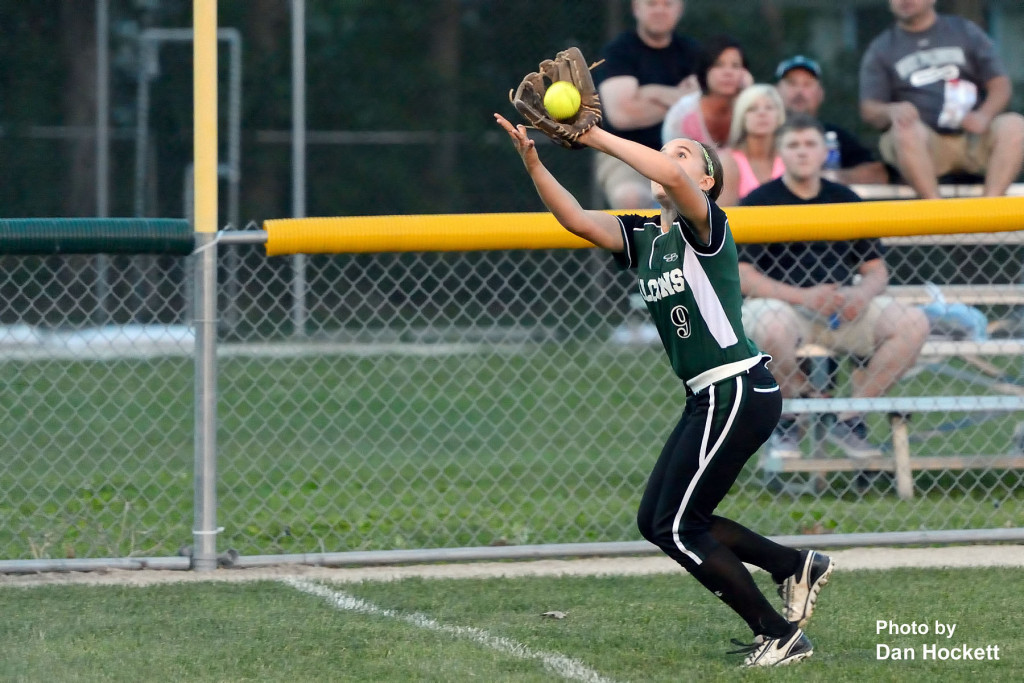 Photo by Dan Hockett West Burlington – Notre Dame Left Fielder Lexy Davis catches a Highland fly ball during Friday night's game in West Burlington. Highland defeated WBND, 4-2.