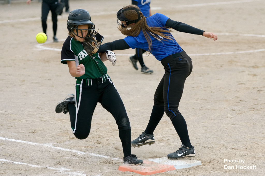 Photo by Dan Hockett West Burlington – Notre Dame base runner Adriana Moad (left) takes a glove to the face from West Liberty First Baseman Haddie Anderson (right) at the same time the ball hits her right shoulder in the first round of Regional play Wednesday night at West Liberty. West Liberty defeated WBND, 3-1.