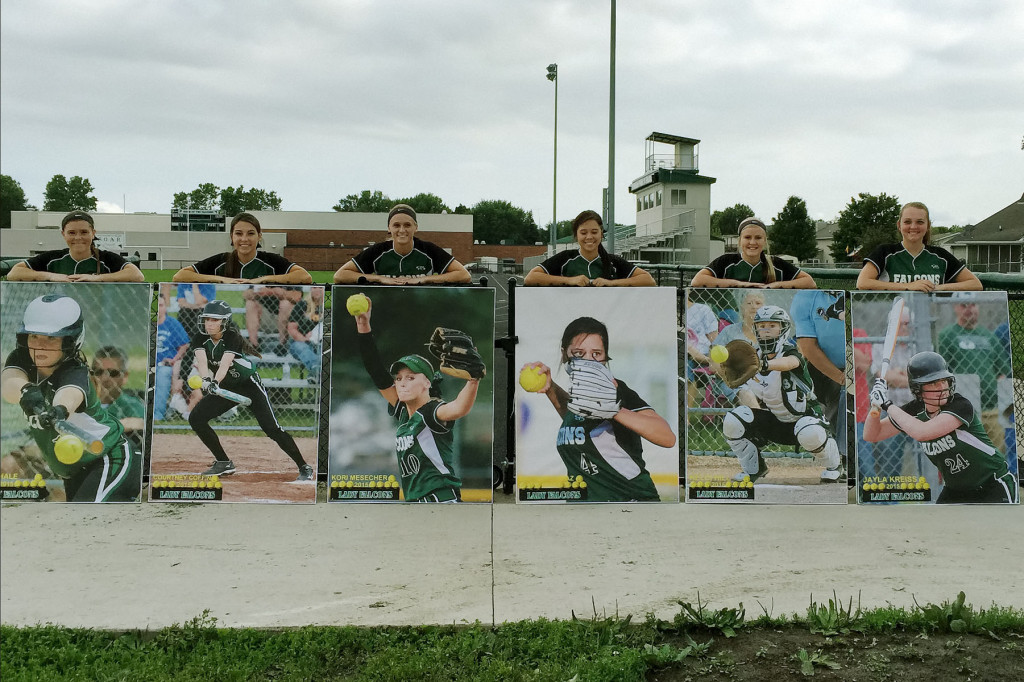 Photo by Steve Coffin West Burlington – Notre Dame Seniors receive larger than life posters as mementos of their time on Falcon Softball Team during Senior Night, Thursday, June 25th at Barb Carter Field in West Burlington. From left: Riley Hale, Courtney Coffin, Kori Mesecher, Machaela Diaz, Kelci Hill, Jayla Kreiss.