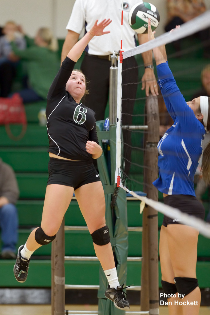 Photo by Dan Hockett West Burlington's Shayleigh Abbott (6) spikes the ball over the net against Danville in first round Region-8 play at West Burlington Tuesday night. WB defeated Danville, 25-21, 25-9, 26-24.