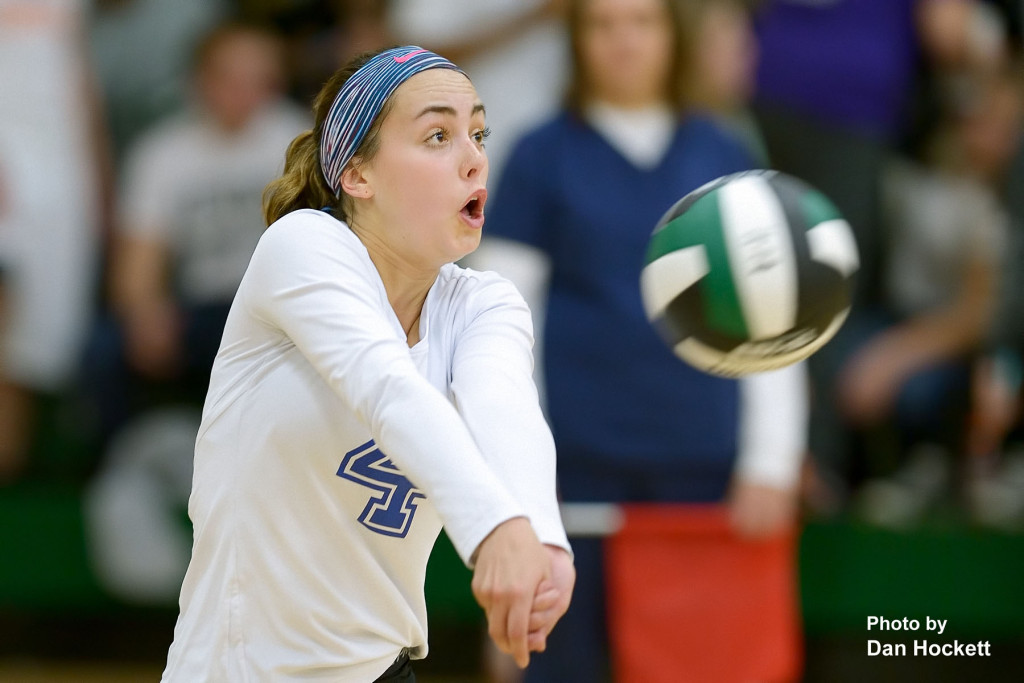 Photo by Dan Hockett Danville Libero Rylea Stringer keeps the ball in play against West Burlington in first round Region-8 play at West Burlington Tuesday night. WB defeated Danville, 25-21, 25-9, 26-24.