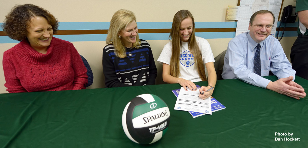 Photo by Dan Hockett West Burlington High School Senior Aubrey Schmitt signs Monday morning to play volleyball at Des Moines Area Community College. Left to right: Anita Schmitt (mother), Patty Harrison - Head Volleyball Coach DMACC, Aubrey Schmitt, David Schmitt (father).