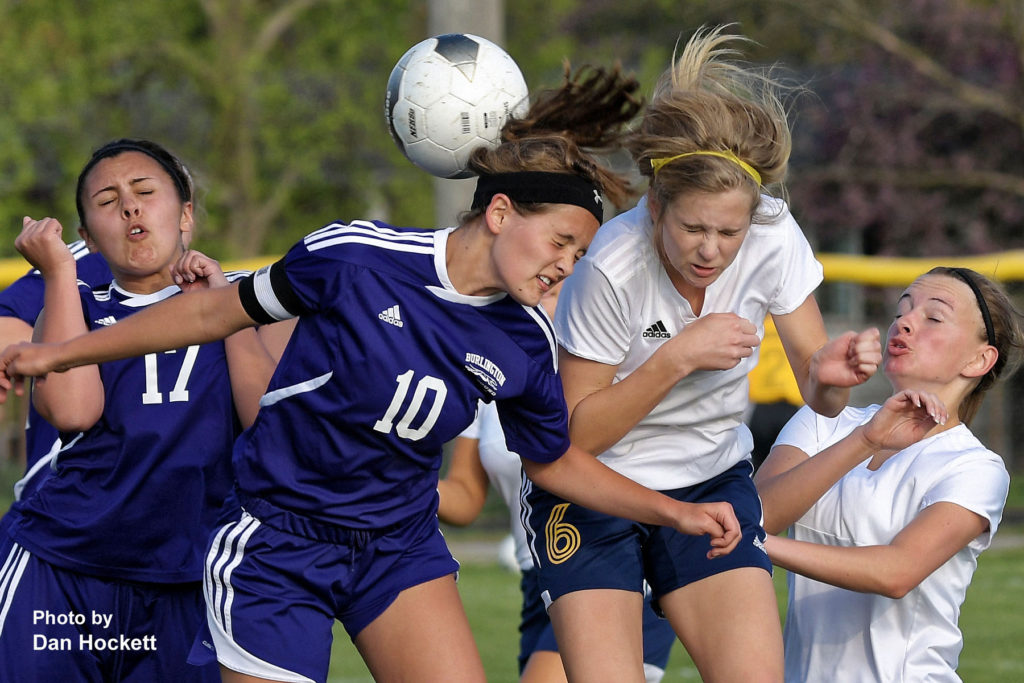 Photo by Dan Hockett Nikes' Anna Tillo (6) and Burlington's Logan Ziegler (10) fight for the ball in front of Burlington's goal with teammates Lydia Eisenmann (17) and Kate Luers (far right) at Tackleson Field Friday night in Burlington. Notre Dame – West Burlington – Danville defeated Burlington, 7-1.