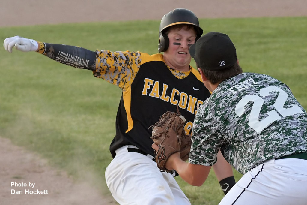 Photo by Dan Hockett West Burlington Third Baseman Jacob Fritz (22) tags L&M's Kyler Bemis out at third in the second inning Friday night in West Burlington. West Burlington defeated L&M, 4-3.