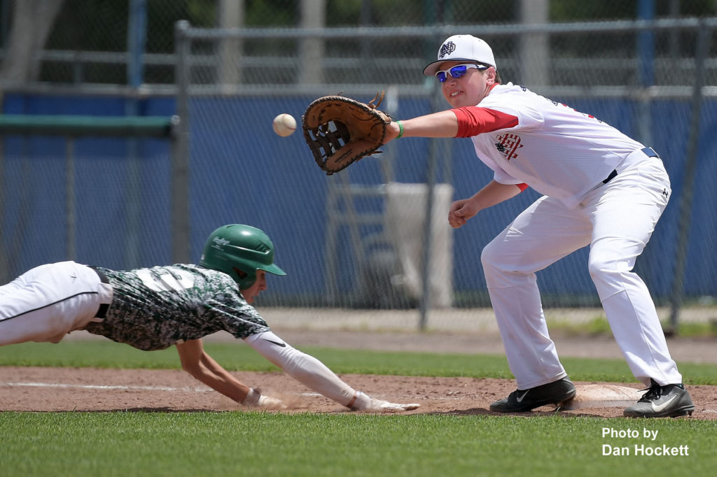 Photo by Dan Hockett Notre Dame First Baseman Connor DeLaney tries to catch West Burlington's Masin Shullaw off first base of their game in the Fun City Classic at Community Field in Burlington Saturday. Notre Dame defeated West Burlington, 10-3.