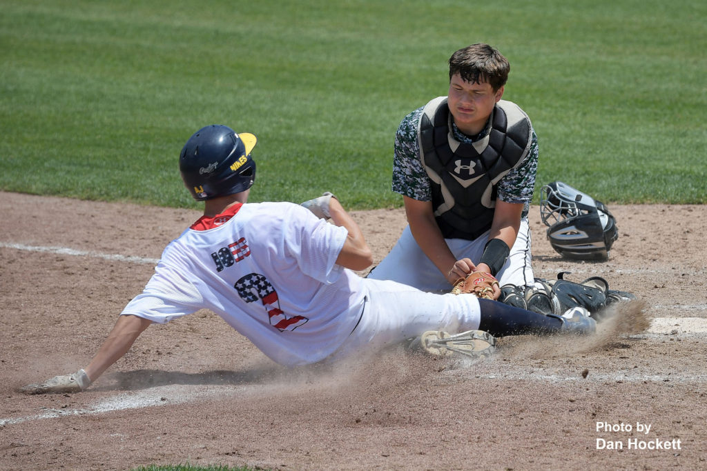 Photo by Dan Hockett West Burlington Catcher Dreyton LaVeine tags Notre Dame's Adam Johs out at the plate in the fourth inning of their game in the Fun City Classic at Community Field in Burlington Saturday. Notre Dame defeated West Burlington, 10-3.