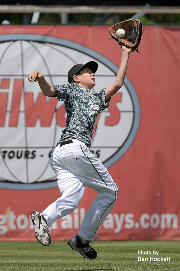 Photo by Dan Hockett West Burlington Leftfielder Jonah Marlow catches a popup hit by Notre Dame's Zach Jaeger in the sixth inning of their game in the Fun City Classic at Community Field in Burlington Saturday. Notre Dame defeated West Burlington, 10-3.