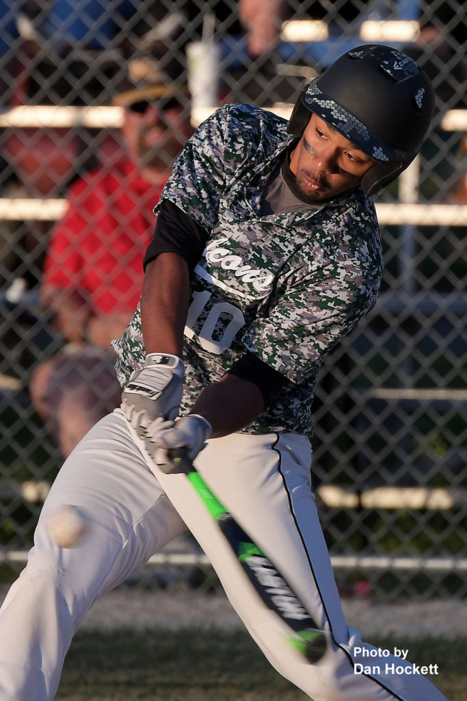 Photo by Dan Hockett West Burlington's Kincaid Mitchell makes contact in the second inning against New London Monday night in West Burlington. West Burlington defeated New London, 2-1.