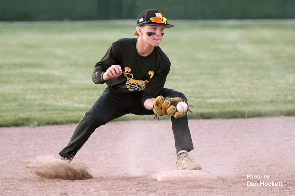 Photo by Dan Hockett New London Second Baseman Sam Loyd makes the tag for an out against West Burlington Monday night in West Burlington. West Burlington defeated New London, 2-1.