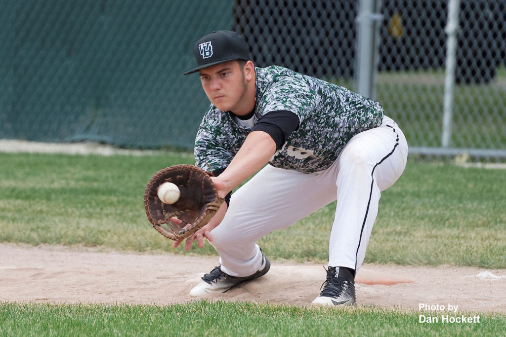 Photo by Dan Hockett West Burlington First Baseman Cameron Guihan makes the tag against Holy Trinity in the first game of West Burlington Tournament Saturday afternoon in West Burlington. WB defeated HTC, 6-2.