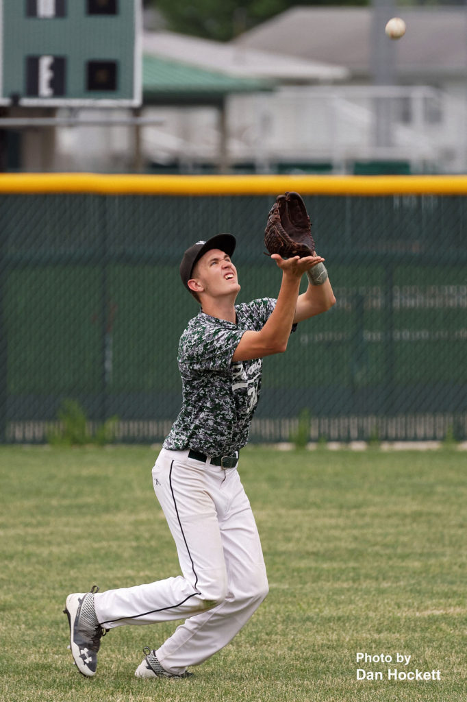 Photo by Dan Hockett West Burlington Leftfielder Colton Hohenthaner gets the out against Holy Trinity in the first game of West Burlington Tournament Saturday afternoon in West Burlington. WB defeated HTC, 6-2.
