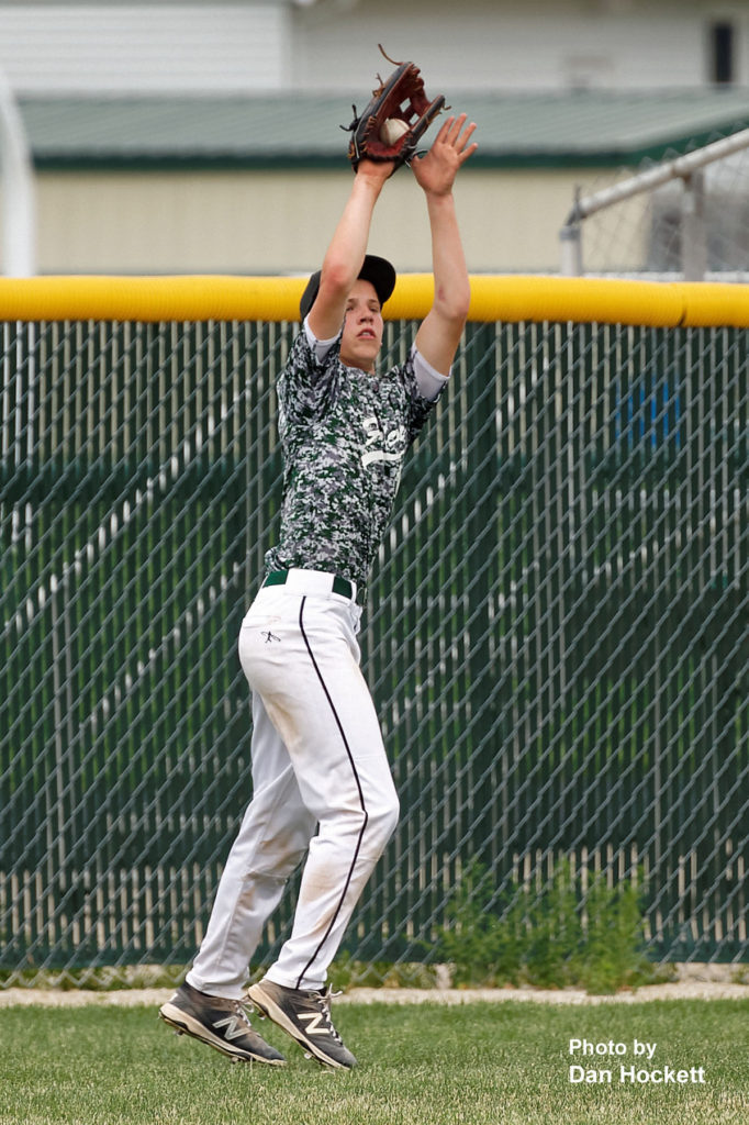Photo by Dan Hockett West Burlington Centerfielder Daniel Crooks makes the out against Holy Trinity in the first game of West Burlington Tournament Saturday afternoon in West Burlington. WB defeated HTC, 6-2.