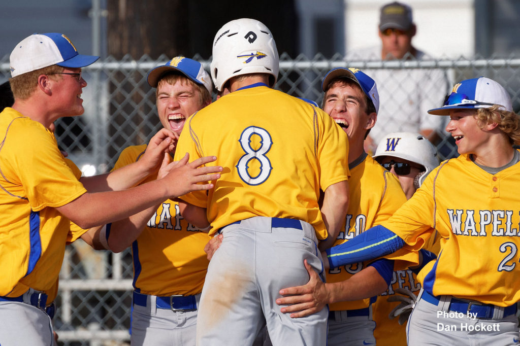 Photo by Dan Hockett Wapello's Trace Howard (8) celebrates with his teammates after hitting a homerun against West Burlington in the West Burlington Tourney Saturday afternoon in West Burlington. Wapello defeated West Burlington, 5-1.