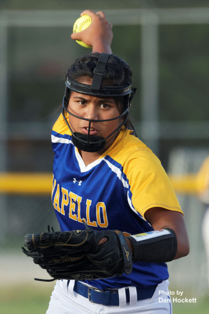 Photo by Dan Hockett Wapello Pitcher Eliza Noa looks to send one across the plate against WBND Tuesday night in West Burlington. Wapello defeated WBND, 8-1.
