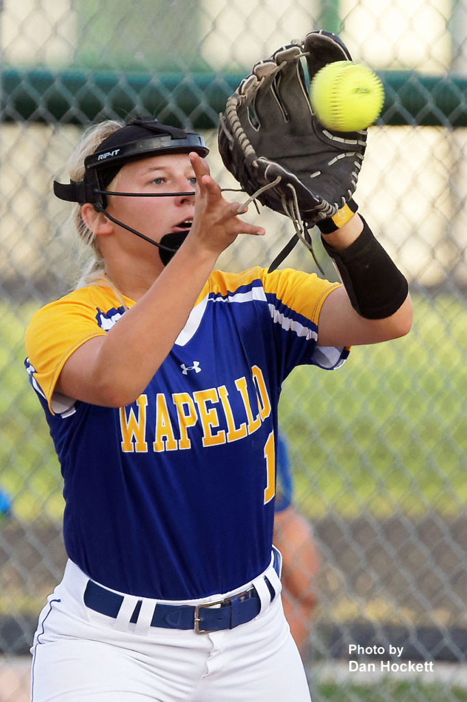 Photo by Dan Hockett Wapello First Baseman Addisyn Lolling makes the play against West Burlington – Notre Dame Tuesday night in West Burlington. Wapello defeated WBND, 8-1.