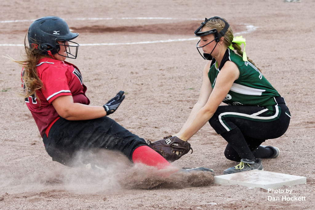 Photo by Dan Hockett West Burlington – Notre Dame Third Baseman Madelyn Stutsman tags sliding Winfield – Mt. Union's Kara Wade out at third Wednesday night in West Burlington. WBND defeated WMU, 4-2.
