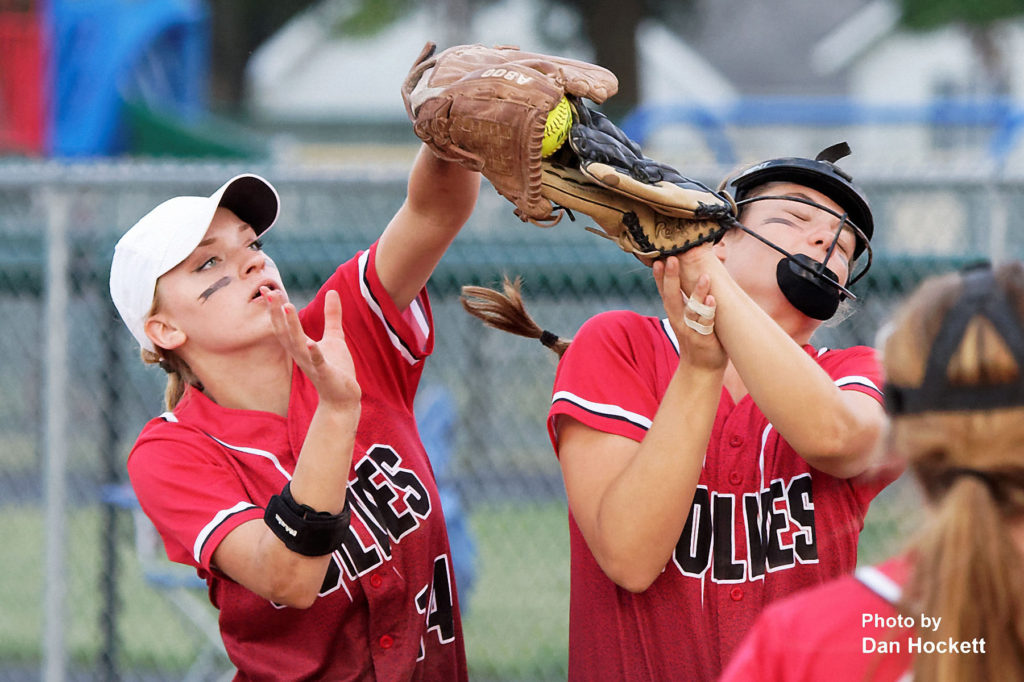 Photo by Dan Hockett Winfield – Mt. Union Second Baseman Lauren Jamsion (left) and First Baseman Hannah Buffington (right) bump together to catch an infield fly Wednesday night in West Burlington. WBND defeated WMU, 4-2.
