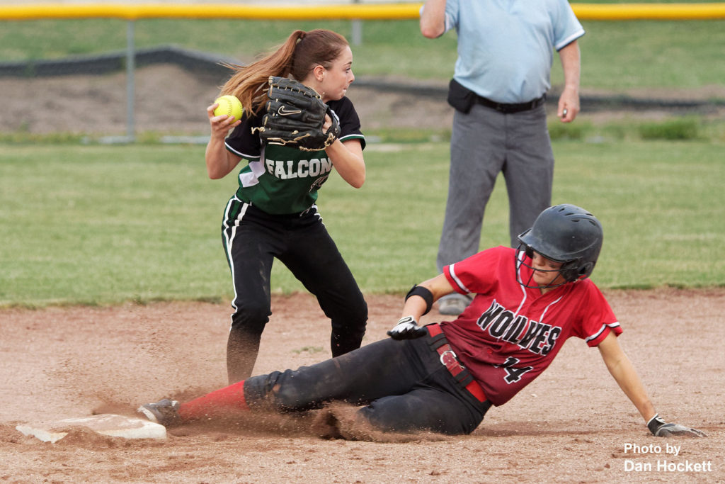 Photo by Dan Hockett West Burlington – Notre Dame Shortstop Makenna Davis looks to first for the double play after getting the force out on Winfield – Mt. Union's Lauren Jamsion (14) Wednesday night in West Burlington. WBND defeated WMU, 4-2.